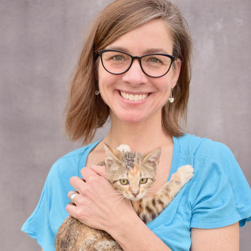 Dr. Ellen Jefferson holding small tabby cat
