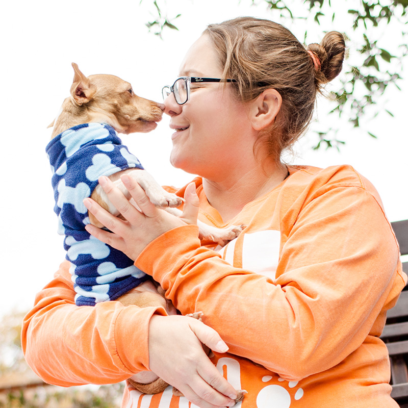 woman nose to nose with dog at austin pets alive