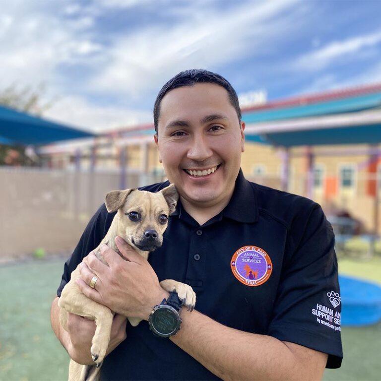 Ramon Herrera holding a dog