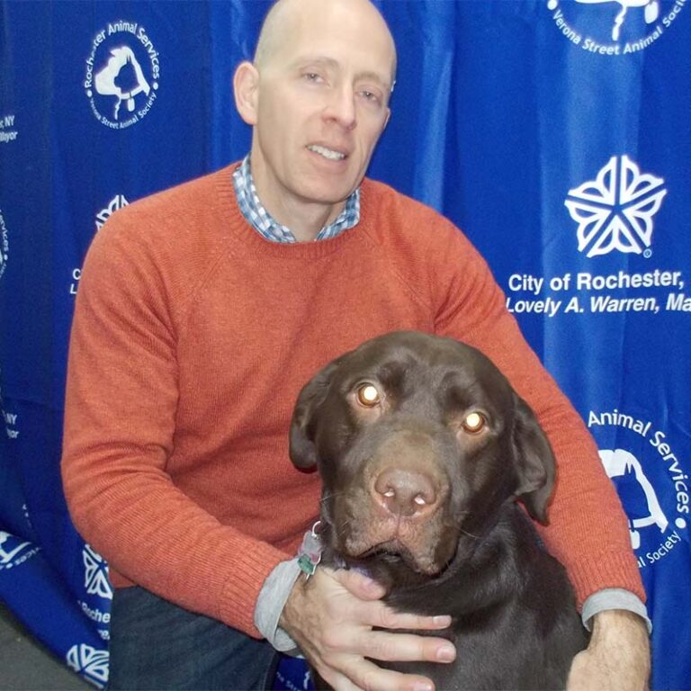 Chris Fitzgerald with Keeva, a brown dog