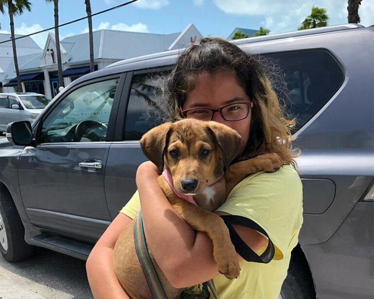 Teen hugging a puppy - Foster Recruitment Blog