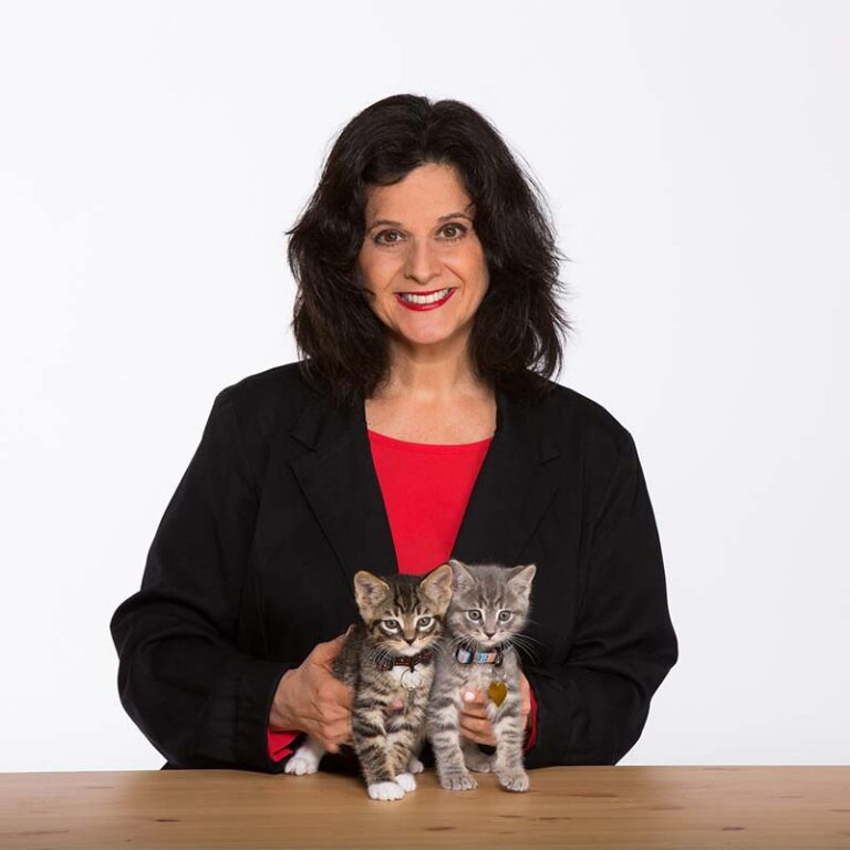 Julie Bank with two kittens smiling at the camera