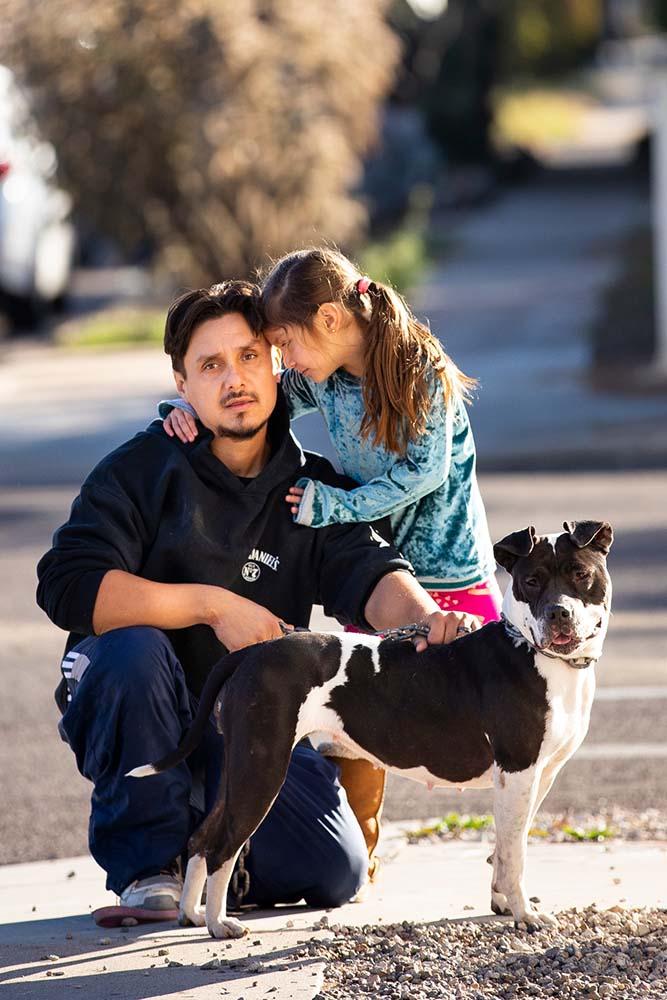 man girl and dog