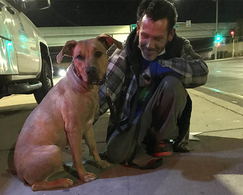 Dog and man experiencing homelessness
